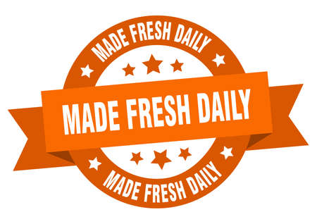 made fresh daily ribbon. made fresh daily round orange sign. made fresh daily