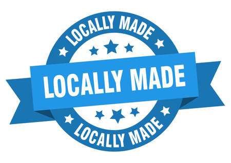 locally made ribbon. locally made round blue sign. locally made