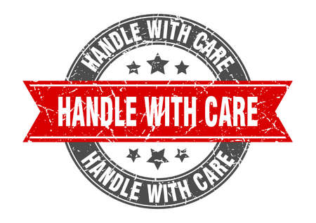 handle with care round stamp with red ribbon. handle with care