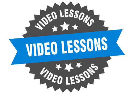 video lessons round isolated ribbon label. video lessons sign