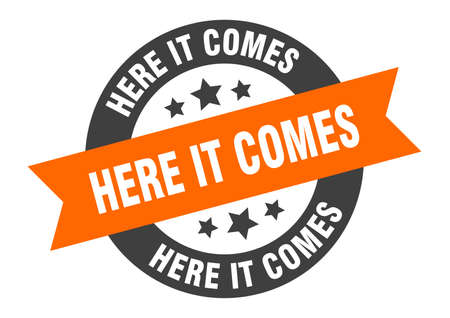here it comes sign. round isolated sticker. ribbon tag