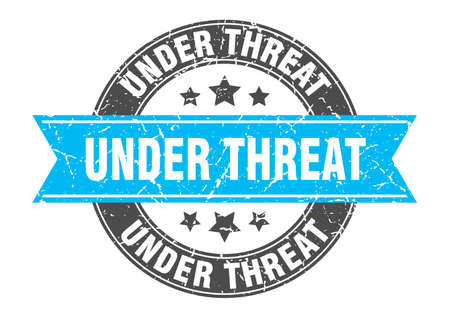 under threat round stamp with ribbon. sign. label