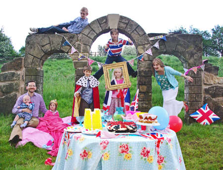 royal wedding: A family standing next to their Kate and William Royal Wedding party picnic.