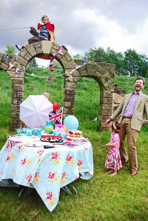 royal wedding: A family laughing as their Royal Wedding picnic blows away.