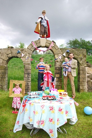 A family standing next to their Kate and William Royal Wedding party picnic.