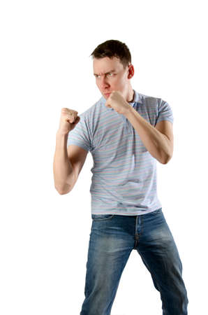 threatens: angry man threatens his fists on a white background isolated