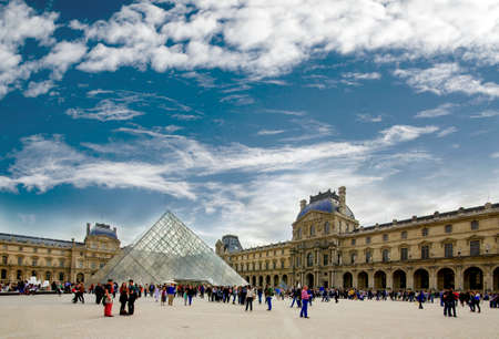 napoleon: Crowded area near the Louvre glass pyramid in the courtyard of Napoleon in Paris Editorial