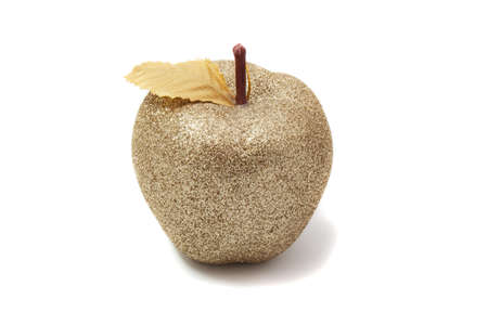 Golden apple shining on a white background photo