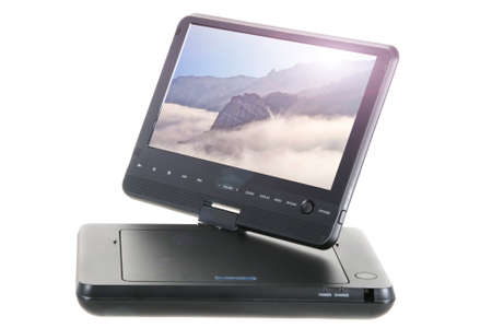 Portable dvd with views of mountains and the sunlight on a white background