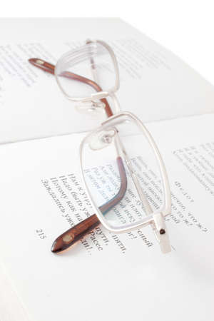 Reading glasses for close-up of open book photo