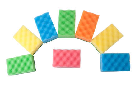 Multicolored sponges of different colors on white lined fan photo