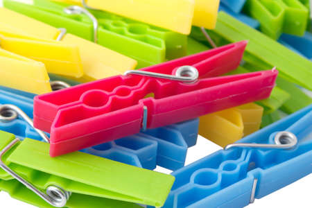 laundry line: clothespins of different colors close-up