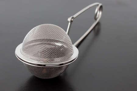tea infuser closeup on black background photo