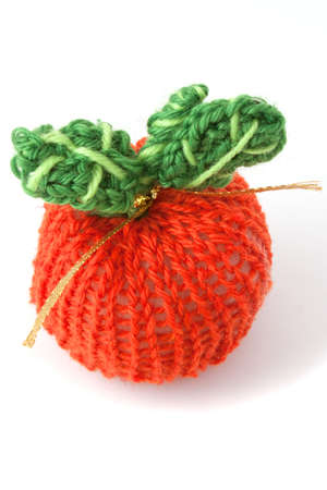 knit apple red with green leaves on white background