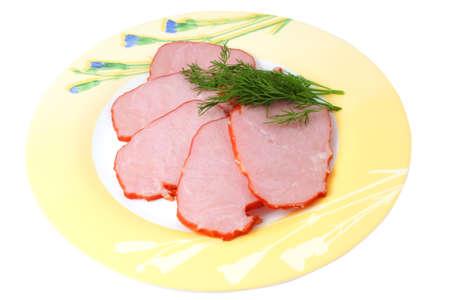 Schinken mit Gemüse auf einem Teller in Scheiben geschnitten Lizenzfreie Bilder