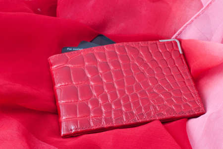credit card wallet red with three credit cards on red fabric Stok Fotoğraf