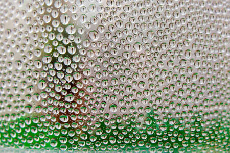 droplets of water with shades of green close-up