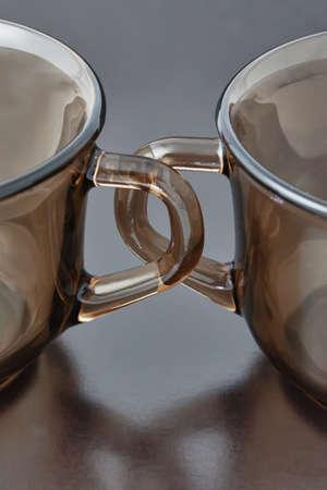 Griffe Tassen auf einem schwarzen Hintergrund Nahaufnahme Lizenzfreie Bilder