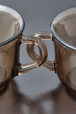 handles cups on a black background closeup Stok Fotoğraf
