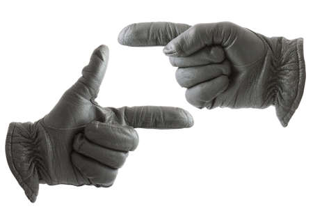 Gloved hands showing the direction photo
