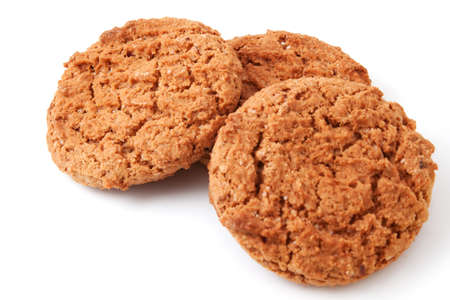 Three oat cookies on a white background