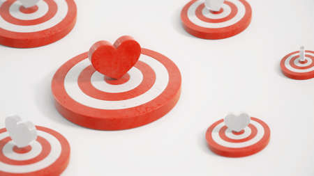 Red heart symbol in the center of a target with red and white hearts targets around 3d render. Valentine's symbols in white studio with camera depth of field effect. Zdjęcie Seryjne