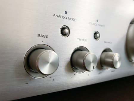 Stereo audio amplifier with tone block close-up.