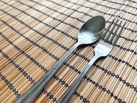 wooden napkin with spoon and fork. Closeup. Zdjęcie Seryjne