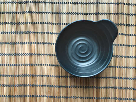 Wooden napkin with black cup. View from above. Zdjęcie Seryjne