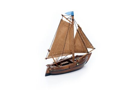 Wooden small ship isolated on white background  photo