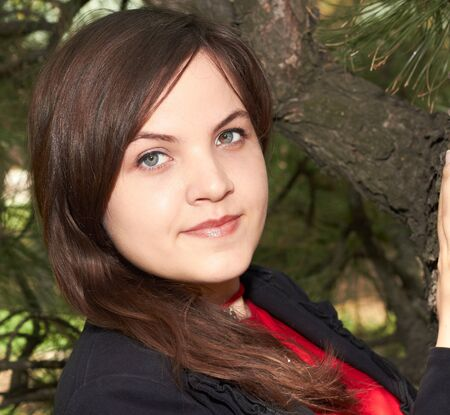 young girl in a black jacket near the tree Stock Photo - 15041346
