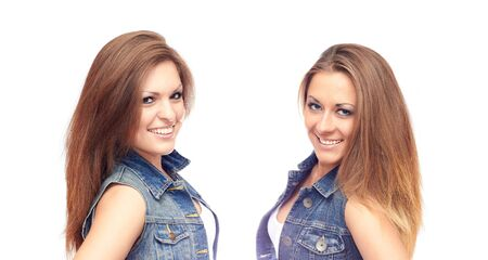 denim jacket: Smiling girls in jeans jackets isolated on a white background Stock Photo
