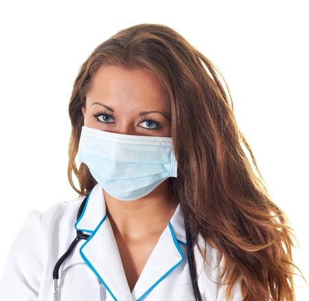 woman doctor in a mask isolated on a white background Stock Photo - 15262351