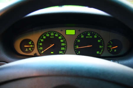rev: Wheel and dashboard of a car