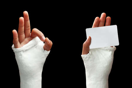 broken arm: Take my broken arm photo  on dark background Stock Photo