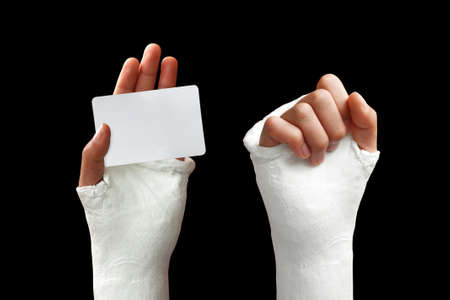 Take my broken arm photo  on dark background Stock Photo