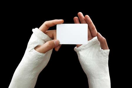 splint: Take my broken arm photo  on dark background Stock Photo
