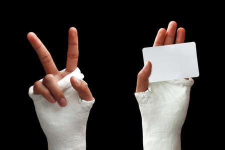 broken wrist: Take my broken arm photo  on dark background Stock Photo