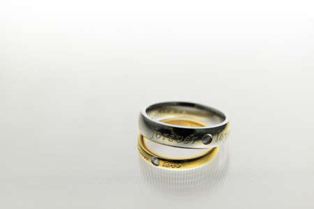 Wedding rings on the white background Stock Photo - 12732880