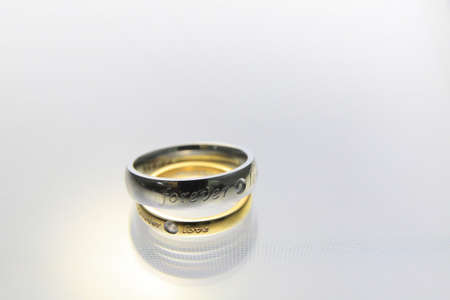 Wedding rings on the white background photo