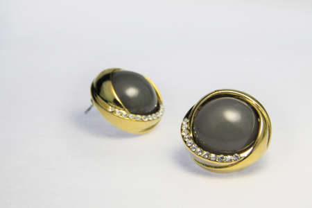 stud: Gold earrings on the white background
