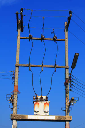 Electricity post with cable wires photo