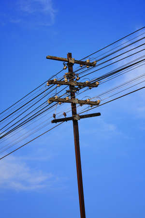 telephone poles: Telephone poles with wires for communication. Stock Photo