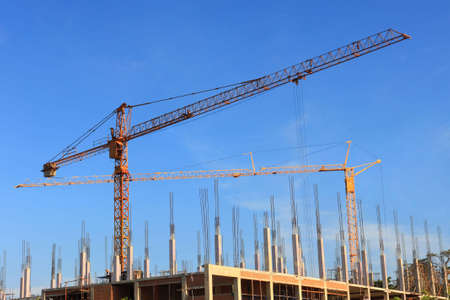 erecting: construction crane with blue sky