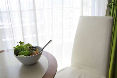 Salad with lettuce leaves in the room