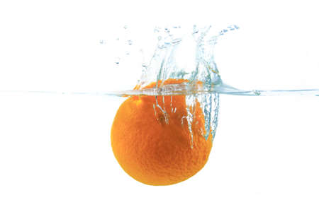 Orange drop to water isolated on white