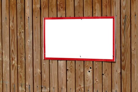 Blank warning sign with red frame on wooden wall