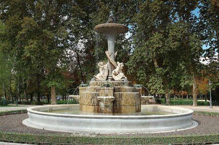 Old fountain in El Retiro park, Madrid photo