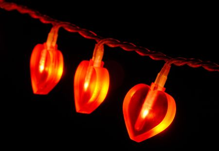 Fragment of glowing red heart shaped  tree or valentine lights garland Imagens