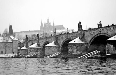 BW view from river to Charles bridge and Prague castle photo